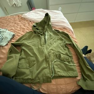 Green cropped rain jacket